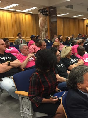 Uber drivers in black shirts and Lyft drivers in pink shirts packed a Senate committee room Tuesday to hear a bill that would have set statewide regulations for ride-sharing companies.