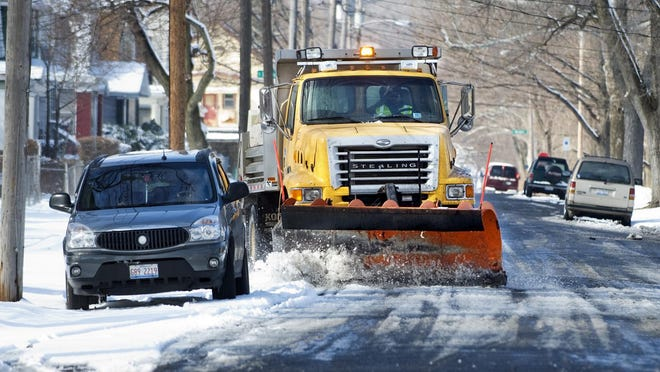 In this 2011 file photo, a Peoria Public Works driver clears snow on Butler Street.