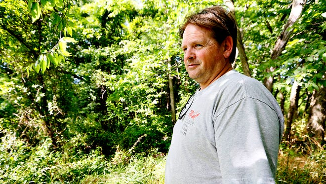 """""""I feel like I'm being forced off of it,"""" said Chris Donley , Tuesday, July 5, 2016, about his third-generation farmland, while voicing his concerns over a recent proposal for a warehouse, which would adjoin his Newberry Township property on three sides. Dawn J. Sagert photo"""