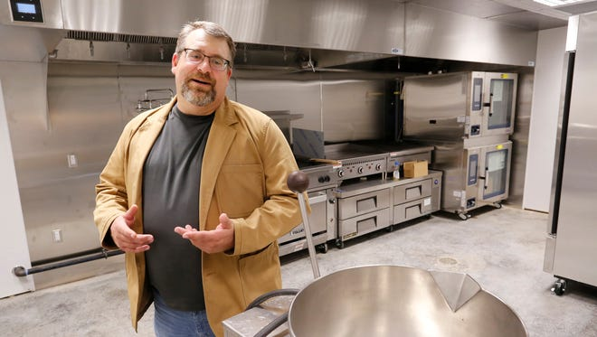 """Colby Bartlett talks about the expansion of Lafayette's riverfront district Friday, July 7, 2017, while inspecting the new commercial kitchen in the Moses Fowler House in Lafayette. """"It (the expansion of the riverfront district) allows us to get a liquor license we wouldn't otherwise be able to get or afford,"""" said Bartlett, who is executive director of the 1852 Foundation. """"It allows us to capture that revenue and support the preservation and operation of the house."""""""