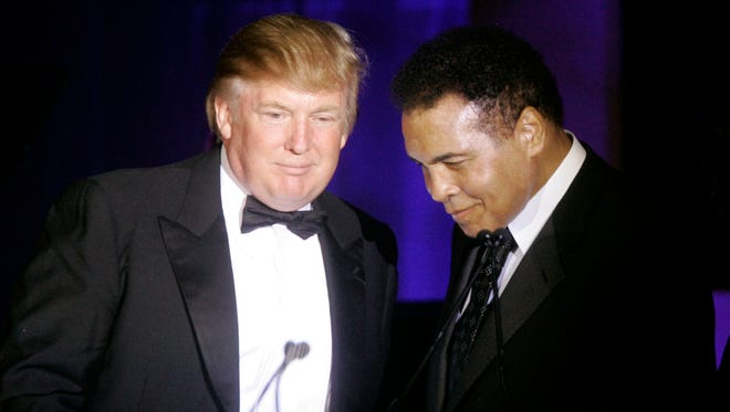 In this March 24, 2007, file photo, Donald Trump, left, accepts his Muhammad Ali award from Ali at Muhammad Ali's Celebrity Fight Night XIII in Phoenix, Ariz.
