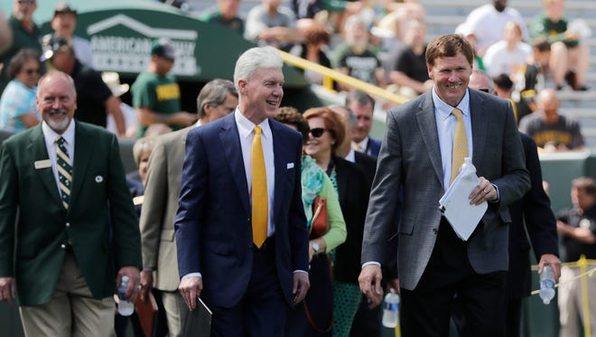Packers President & CEO Mark Murphy and General Manager Ted Thompson lead the board onto the field at the annual Green Bay Packers shareholders meeting at Lambeau Field on Monday, July 24, 2017, in Green Bay.
