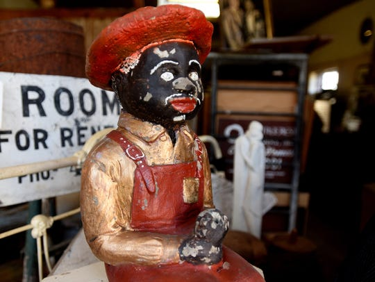 A sculpture once displayed in yards during segregation in the South is not as prominent today.  Anderson has acquired several over the years.
