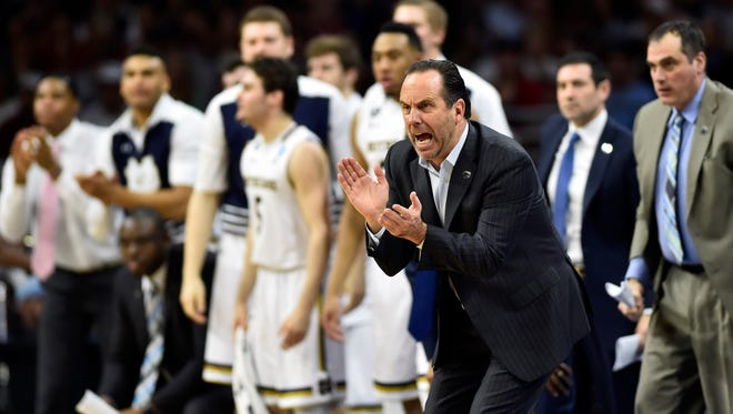 Notre Dame Fighting Irish coach Mike Brey reacts to a play against the Wisconsin Badgers during the second half in a semifinal game in the East regional of the NCAA Tournament at Wells Fargo Center.