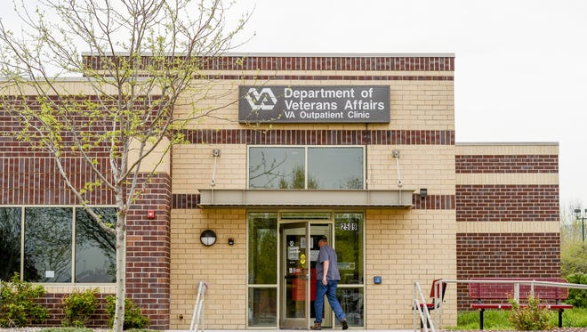 A man walks into the VA outpatient clinic in Fort Collins in this May 5, 2014, file photo. A new federal report pins a scheduling scandal on a single manager.