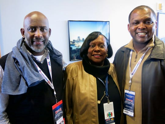 Darrin Dixon, chairman of the African America Chamber of Commerce, Caddo School Board member Dottie Bell, Caddo School Superintendent Lamar Goree partying in the mayor's suite during bowl game.