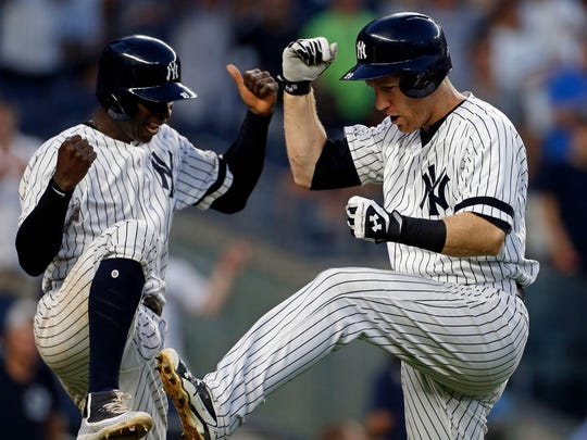 Yankees third baseman Todd Frazier, right, celebrates hitting a two-run home run with Yankees Didi Gregorius (18) against the Baltimore Orioles during the seventh inning at Yankee Stadium on Saturday, Sept. 16, 2017. Gregorius clubbed a three-run homer in the game.