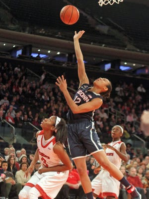 Saniya Chong of UConn shoots over Aliyyah Handford of St. John's during the Maggie Dixon Classic at Madison Square Garden. Chong, an Ossining native, was scoreless in six minutes.
