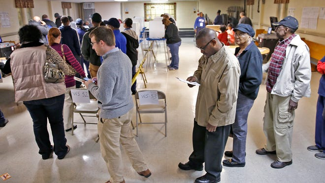 Voters wait in line at Crooked Creek Baptist Church, Tuesday, November 8, 2016.  There are three precincts in this polling site.