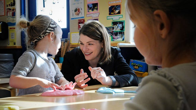 Revenue Commissioner Cynthia Bauerly talks with children Wednesdat during a visit to New Horizon Academy in Sartell. Bauerly made the visit to promote a plan to expand a tax credit that would help families pay for child care.