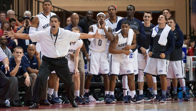 Monmouth coach King Rice and the Hawks' bench react during the second half of their win over Notre Dame at the AdvoCare Classic in Lake Buena Vista, Florida.