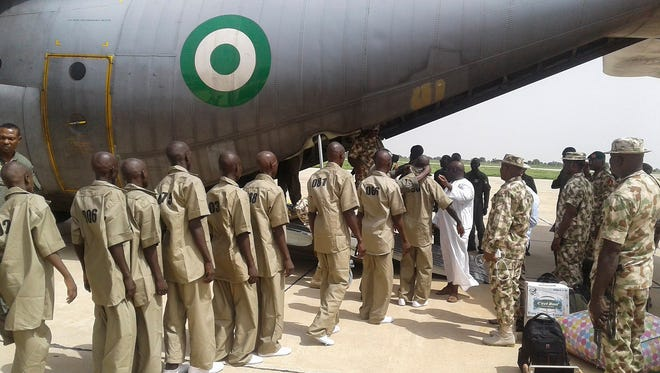 Surrendered Boko Haram Islamic militants are loaded onto an aircraft by the Nigerian military to be taken to a rehabilitation centre in Gombe where they reportedly are to begin a de-radicalization process, in Maiduguri, Nigeria onJuly 8, 2017. According to the Chief of Army Staff, Lt.-Gen. Tukur Buratai about 700 Boko Haram insurgents around the fringes of Sambisa Forest in Borno have surrendered. It is regarded a major development in the war on terror in Nigeria where the Nigerian army has been pushing back militants and fighting to drive them from their strongholds in North East Nigeria.