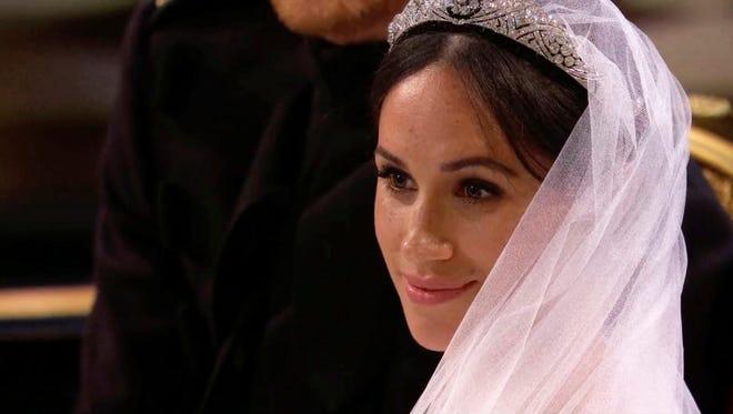 Meghan Markle listens during her wedding ceremony.
