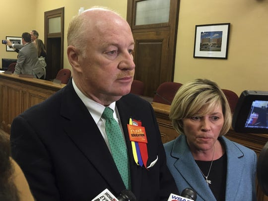West Virginia Education Association President Dale Lee, left, and American Federation of Teachers' West Virginia chapter President Christine Campbell talk to reporters in 2018, at the Capitol in Charleston, W.Va.
