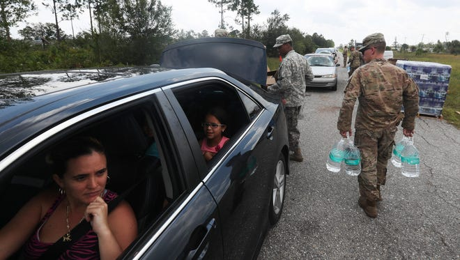 Members of the National Guard distribute water and food to those that need it in Lehigh Acres, Florida on Thursday 9/14/2017.