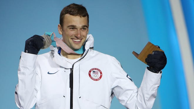 Nick Goepper displays his silver medal at the 2018 Winter Olympics.