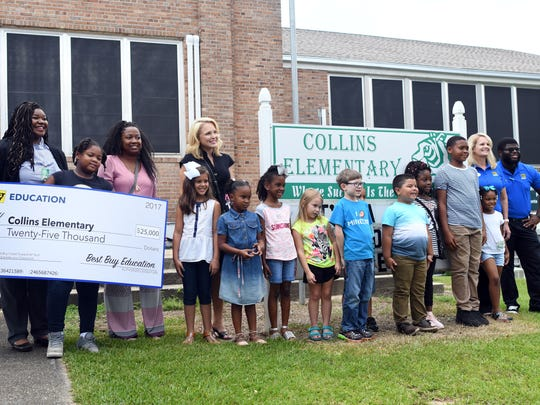 Collins Elementary music teacher Ashley Henry, left, won money for her school by submitting a winning tweet to Best Buy. Her class and students will receive $25,000 in HP Educational Technology, including keyboards, headphones, music software, professional development support and more, for the music classroom.