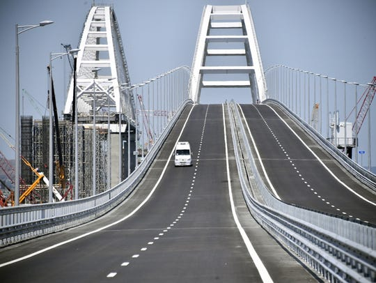 A car drives on the Krymsky (Crimean) Bridge over the