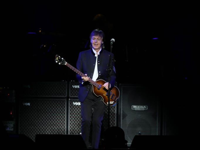 Paul McCartney performs for fans at Little Caesars
