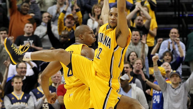 Pacers forwards David West and Evan Turner (12) celebrate during Indiana's 84-83 win against Miami on Wednesday night.