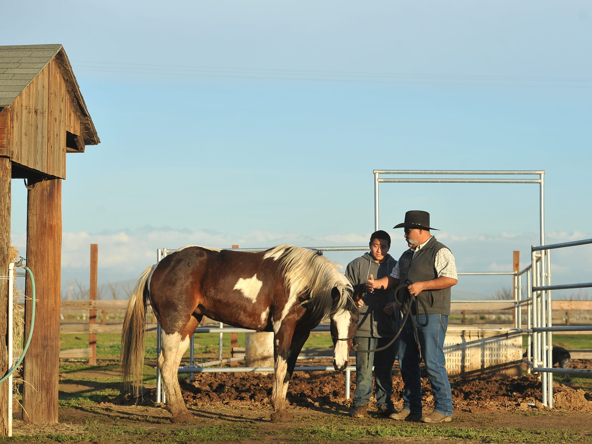 JM Ranch owner Joe Flores speaks with A.L.P.H.A. student Ramon Garcia Moran of El Monte Middle School on Friday, January 15, 2016.