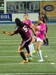 Carlsbad's Gabby Aragon and Gadsden's Denisse Gonzalez battle for possession in the first half Tuesday.