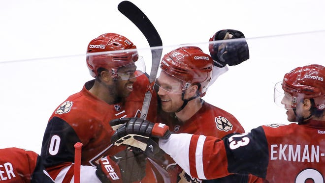 Coyotes left wing Anthony Duclair (10) greets center Max Domi (16) after his hat trick against the Edmonton Oilers on Tuesday, Jan. 12, 2016 in Glendale.