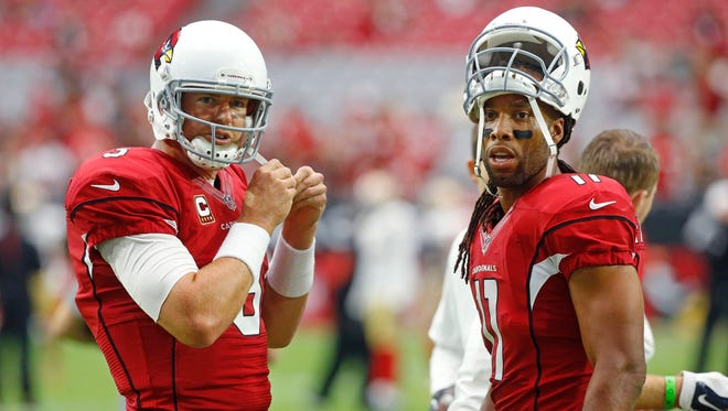 Arizona Cardinals quarterback Carson Palmer and Larry Fitzgerald during the 2015 season.