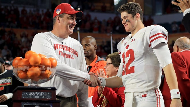 Head coach Paul Chryst and Alex Hornibrook celebrate after winning the 2017 Capital One Orange Bowl.
