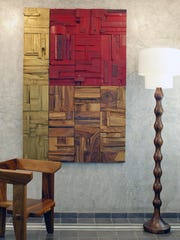 Wood artist Peter Glassford shows one of his collages made out of offcuts of Parota and Rosa Morada, two Central American hardwoods. The offcuts come from furniture making. The positive response to his original wood art collages led him to create panels for the mass market, which can be used as screens, wall art and feature walls.