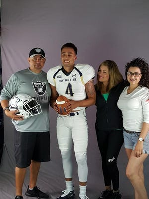 Ruben Beltran surrounded by his family.