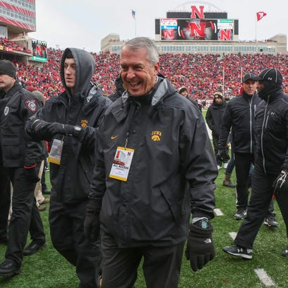Iowa athletic director Gary Barta is all smiles after the Iowa Hawkeyes finish the regular season with a perfect 12-0 with a 28-20 win over Nebraska at Memorial Stadium in Lincoln, Nebraska, on Friday, Nov. 27, 2015.