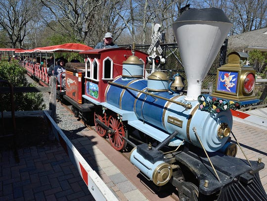 Families ride the train at the Bergen County Zoo during