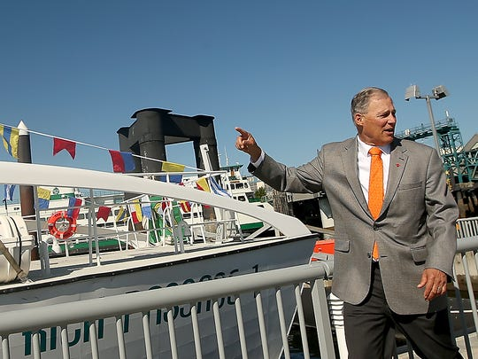 Governor Jay Inslee examines Kitsap Transit's Rich Passage 1 passenger-only ferry on Wednesday.
