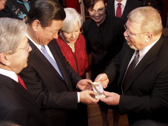 Muscatine Mayor Dwayne Hopkins, right, presents China's then-vice president, Xi Jinping, with a key to the city as, from left, Iowa Gov. Terry Branstad, Sarah Lande, and Lt. Gov. Kim Reynoldls look on Wednesday, Feb. 15, 2012, in Muscatine, Iowa.