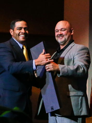 Aaron Padilla receives his award from Scott Turner during the 20 under 40 banquet Thursday, Nov. 2, 2017, at C.J. Davidson Conference Center at Angelo State University.