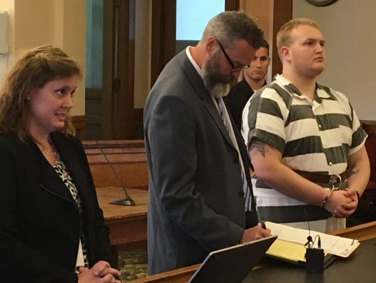 Justin Ray, right, pleaded not guilty Friday to charges