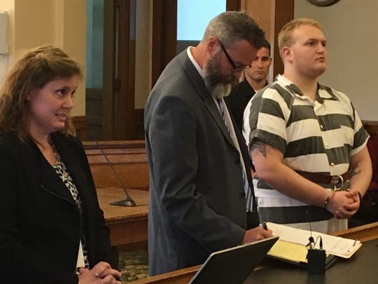Justin Ray, right, pleaded not guilty Friday to charges in connection to the death of his adoptive sister, 16-year-old Sabrina Ray, who was found dead in their family home May 12. She weighed 56 pounds at the time of her death.