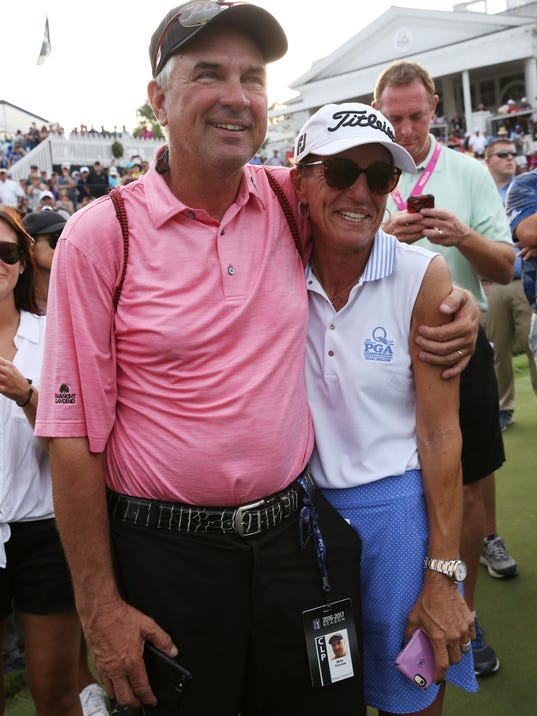 Jani, right, and Mike Thomas watch their son Justin Thomas win the PGA Championship golf tournament at the Quail Hollow Club Sunday, Aug. 13, 2017, in Charlotte, N.C. (AP Photo/John Bazemore)