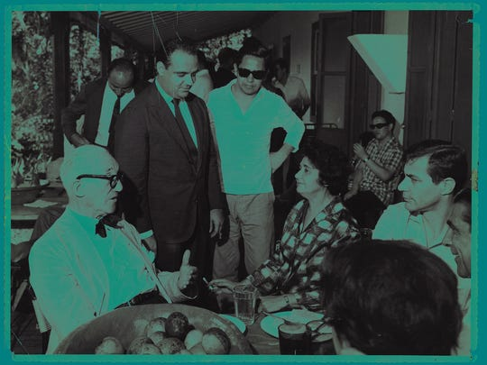 """This historical photograph of Sergio Rodrigues, standing left in black suit, with Le Corbusier, sitting left, and others is featured in the book """"Brazil Modern: The Rediscovery of Twentieth-Century Brazilian Furniture."""""""