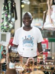 "Mamadou Gaye poses for a portrait at his ""Timbuktu"""