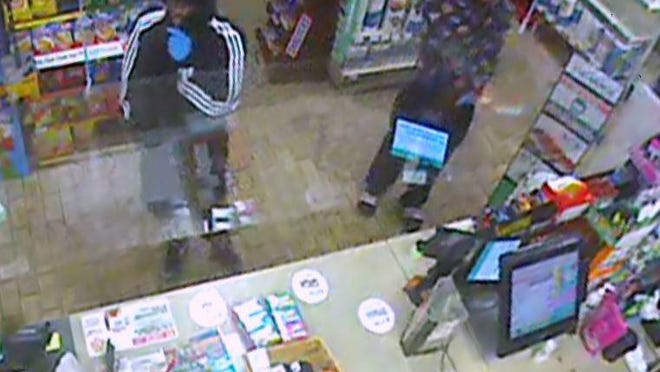 A surveillance footage still shows two suspects who robbed 7-Eleven at the corner of Division and Beecher streets in Adrian early Sunday morning. They have been described as Hispanic males in their late teens or early twenties.