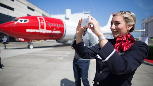 A Norwegian Air crew member captures images of the