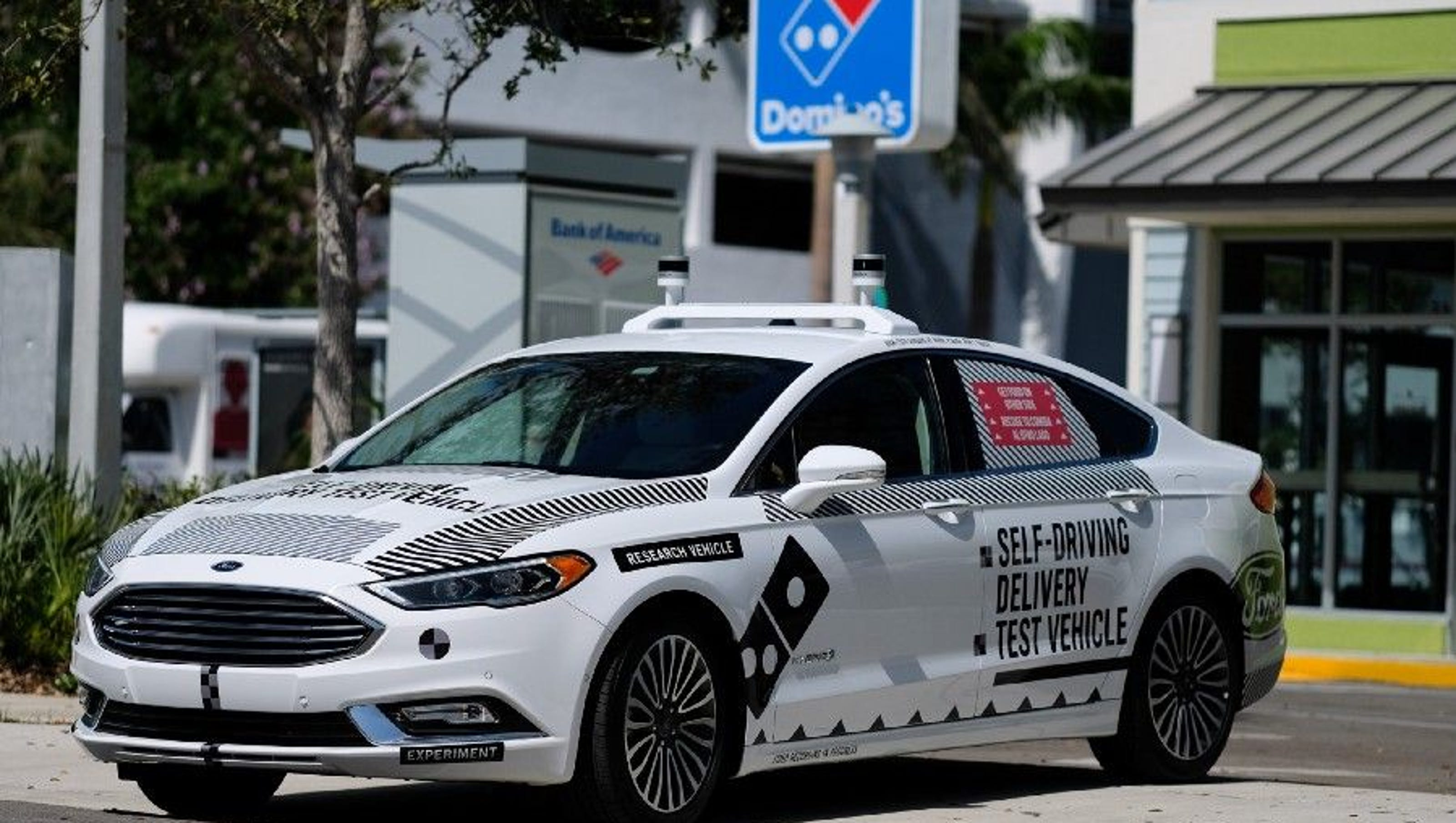 Ford picks miami for self driving vehicle test in dominos postmates partnership