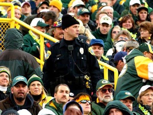 635773571306042862-cops-in-stands