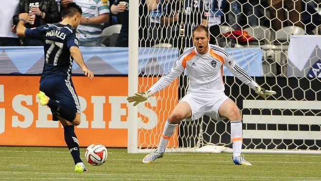 Vancouver Whitecaps midfielder Pedro Morales (77) takes a shot against Colorado Rapids goalkeeper Clint Irwin (1) during the second half at BC Place. The Colorado Rapids won 2-1.