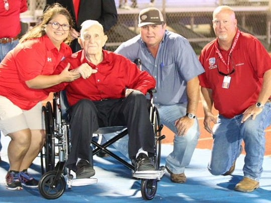 Former Gregory-Portland coach Ray Akins with some athletes