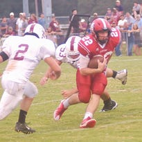 Mikey Chennault splits a pair of defenders Friday night in Jo Byrns 28-11.