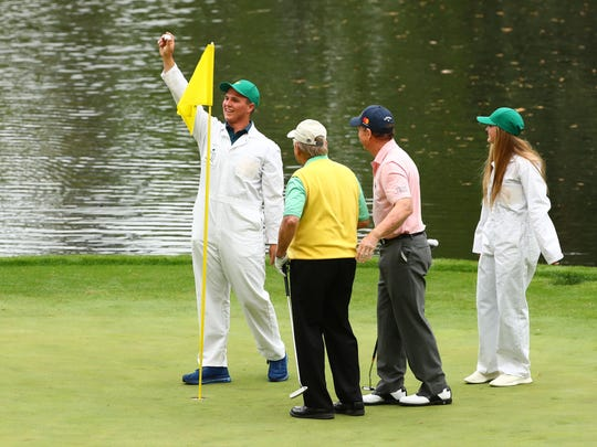 Apr 4, 2018; Augusta, GA, USA; Gary Nicklaus, Jr. the grandson of Jack Nicklaus holds up the ball after making a hole-in-one on the 9th hole during the Par 3 Contest before the Masters golf tournament at Augusta National Golf Club. Mandatory Credit: Rob Schumacher-USA TODAY Sports