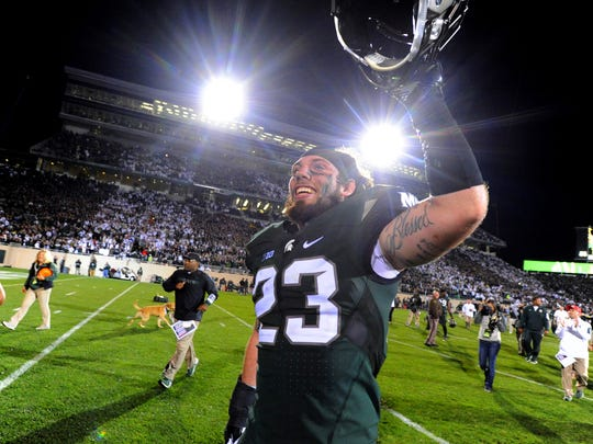 MSU linebacker Chris Frey celebrates after the Spartans' tight 31-28 win over   Oregon at Spartan Stadium in East Lansing Saturday 9/12/2015.
